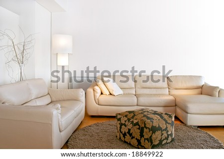 Bright living room with two big sofas - stock photo