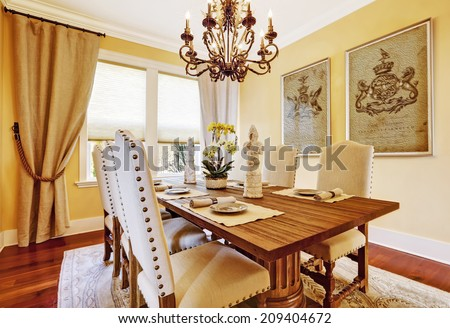 Bright luxury dining room with rich carved wood table - stock photo