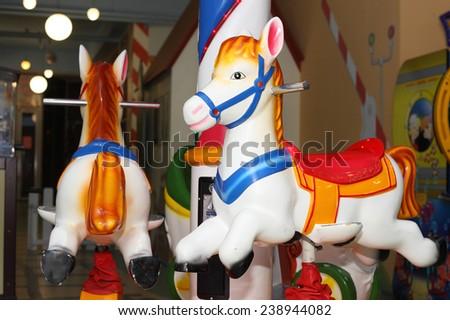 bright merry go round carousel - stock photo