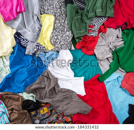 Bright messy colorful clothing - stock photo