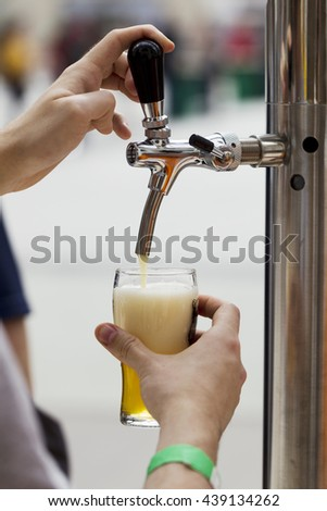 Bright metal beer tap, natural light, sunlight - stock photo