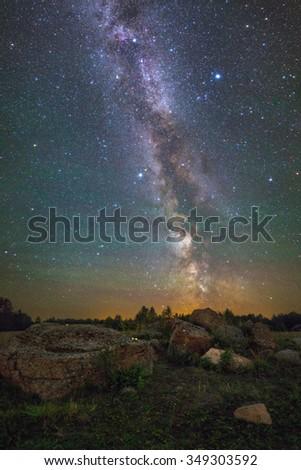 Bright Milky Way over the rocks - stock photo