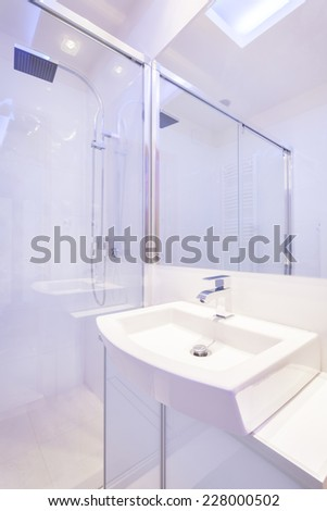 Bright modern bathroom with spacious shower - stock photo