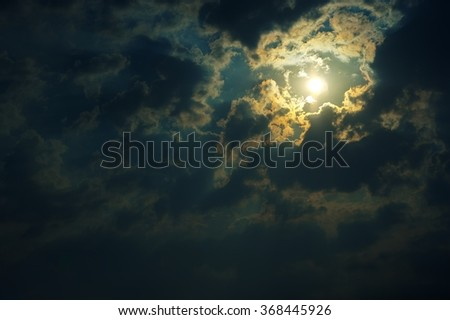 bright moon in the clouds at night - stock photo