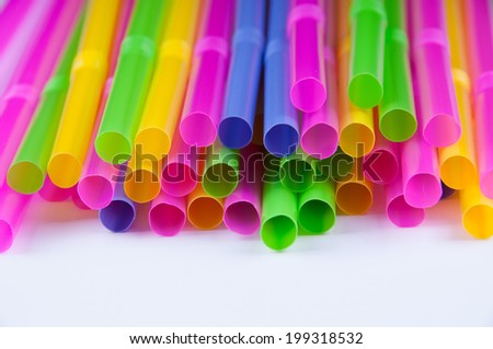 bright multicolor straw on the white screen