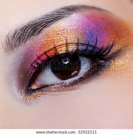 bright multicoloured make-up on the female eye - macro shoot - stock photo