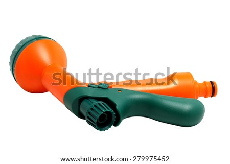 bright nozzle on a hose for watering - stock photo