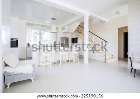 Bright open kitchen in modern interior, horizontal  - stock photo