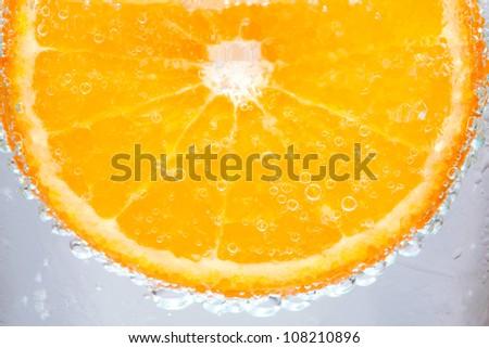 Bright orange color in the water. - stock photo