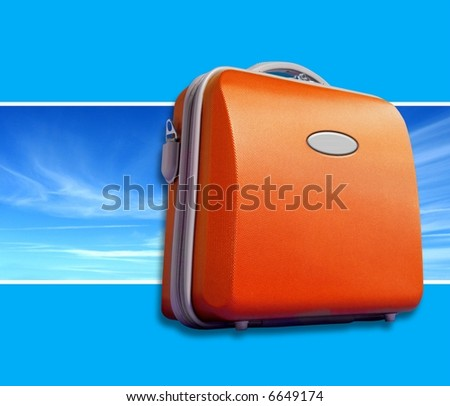 Bright orange suitcase against sky panorama shot. Bright blue background with room for text
