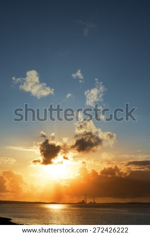bright orange sunset over a power station on the river shannon in ireland - stock photo