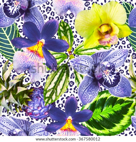 Bright orchid flowers with green exotic leaves on the leopard skin background. Tropical pattern. Photo collage with exotic plants. Yellow, blue and green colors. - stock photo