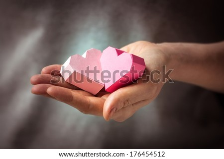 Bright paper hearts in woman hands - stock photo