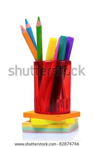 Bright pastels and markers in holder isolated on white