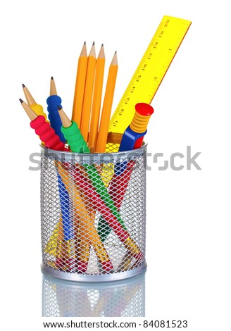 Bright pencils, pen and  ruler in holder isolated on white - stock photo