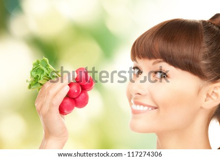 bright picture of beautiful housewife with radish - stock photo