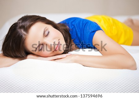 bright picture of beautiful sleeping woman - stock photo