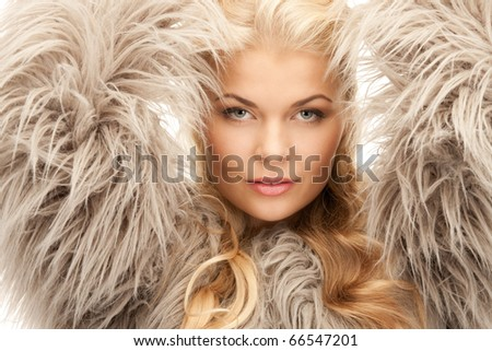 bright picture of beautiful woman in fur