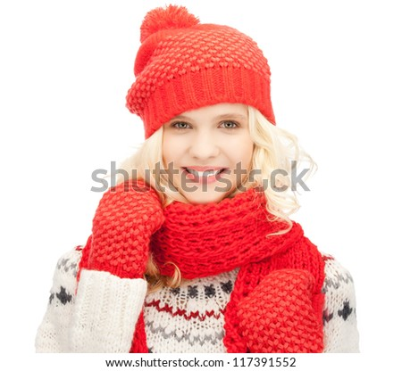 bright picture of beautiful woman in hat, muffler and mittens .. - stock photo