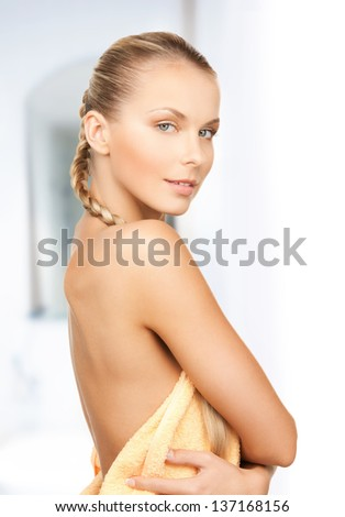 bright picture of beautiful woman in towel - stock photo