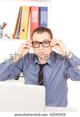 bright picture of businessman with laptop computer in office