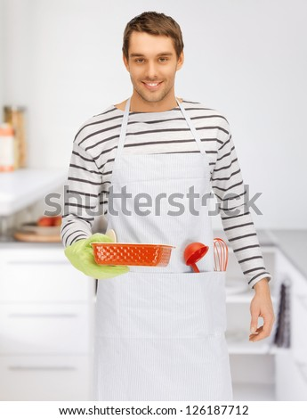 bright picture of cooking man at kitchen - stock photo