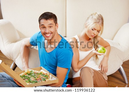 bright picture of couple eating different food - stock photo