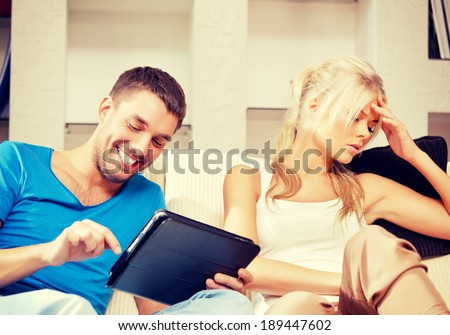 bright picture of couple with tablet PC - stock photo