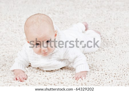 Bright picture of crawling baby lying in blanket