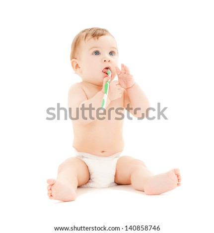 bright picture of curious baby brushing teeth. - stock photo