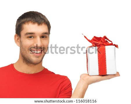 bright picture of handsome man with a gift . - stock photo