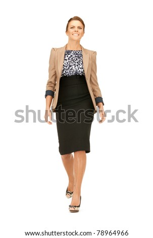 bright picture of happy and smiling walking woman