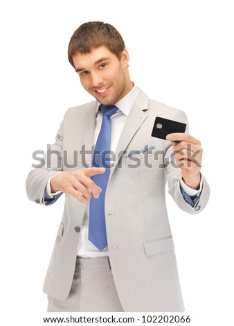 bright picture of happy businessman with credit card - stock photo