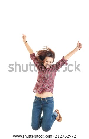 bright picture of happy jumping smiling woman in red shirt showing thumbs up with raised arms high - stock photo