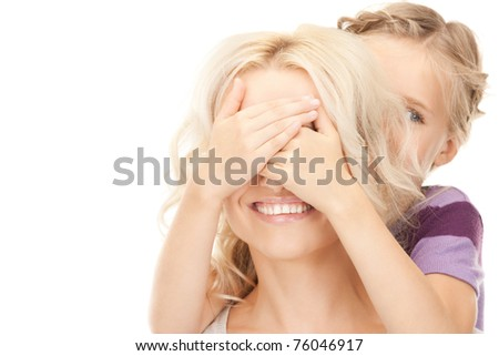 bright picture of happy mother and little girl (focus on hands) - stock photo