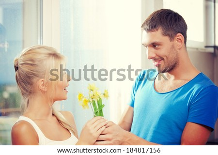 bright picture of happy romantic couple with flowers - stock photo