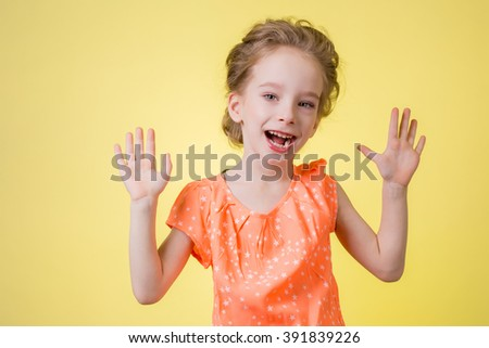 bright picture of happy teenage girl showing her palms. - stock photo