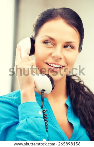 bright picture of happy woman with phone - stock photo