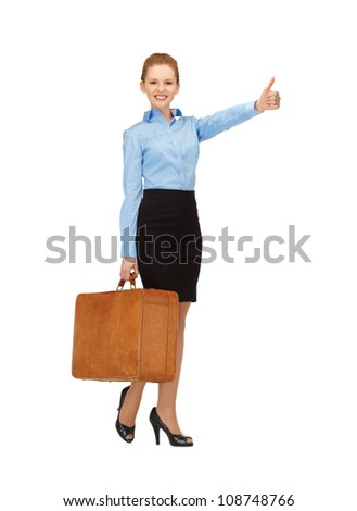 bright picture of hitch-hiking woman with suitcase - stock photo