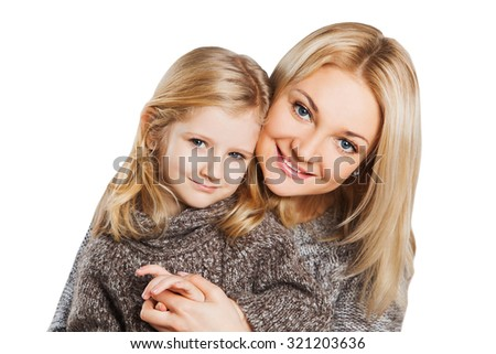 Bright picture of hugging happy mother and daughter - stock photo