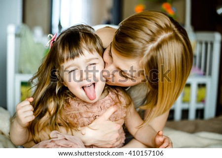 bright picture of hugging mother and daughter. Happy mother and daughter hugging - stock photo