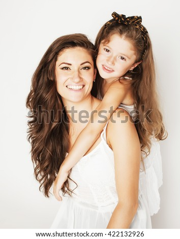 bright picture of hugging mother and daughter happy together, smiling stylish family. girls aloud - stock photo