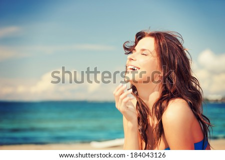 bright picture of laughing woman on the beach - stock photo