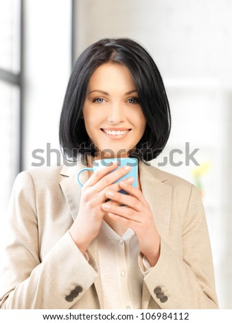 bright picture of lovely businesswoman with mug