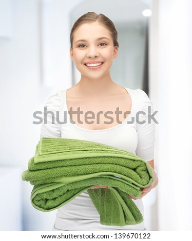bright picture of lovely girl with towels. - stock photo