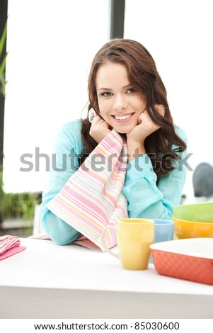 bright picture of lovely housewife at the kitchen - stock photo