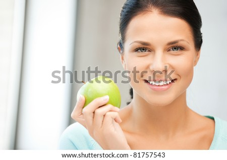 bright picture of lovely housewife with green apple - stock photo