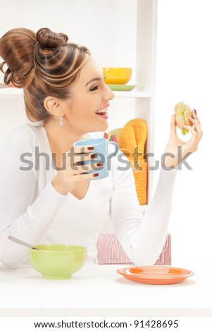 bright picture of lovely housewife with sandwich