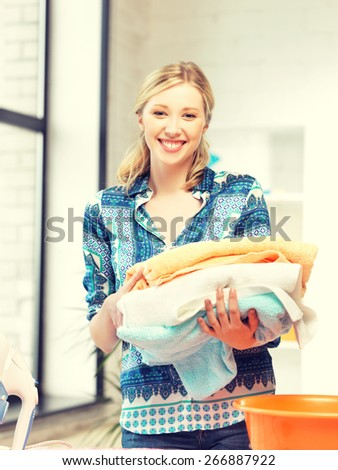 bright picture of lovely housewife with towels. - stock photo