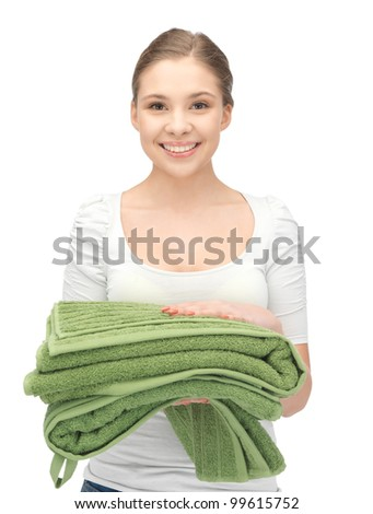 bright picture of lovely housewife with towels - stock photo